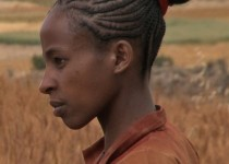 """Alemi Tsegaye on her parents' small holding in a scene from Jerry Rothwell's documentary """"Town of Runners."""" Photo Credit: Jerry Rothwell"""