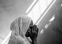Persecution in Pakistan. Portrait of a Christian female praying, 58, in Pakistan. Photo Credit: © Gary S. Chapman.