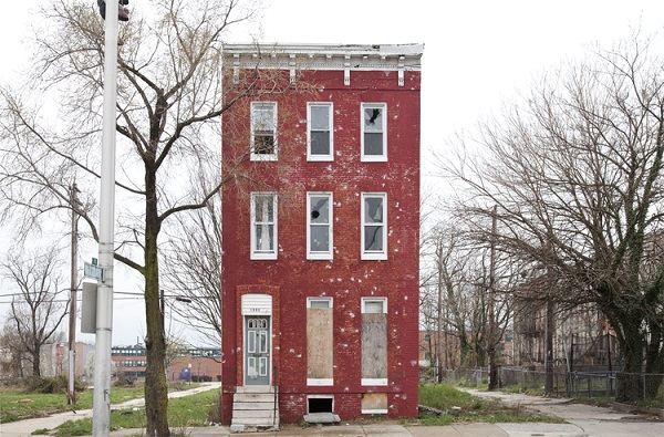 "A photo taken of a building in Baltimore, MD for the ""Last House Standing"" series by Ben Marcin. Photo Courtesy of: Ben Marcin."