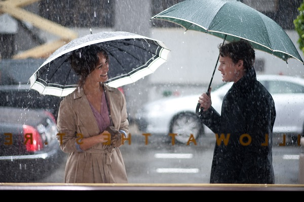 "Brian (Anton Yelchin) braves the rain in order to reunite with Arielle (Bérénice Marlohe) in the smoking nook outside the St. Regis Hotel, the place of their first encounter in the film ""5 to 7."" Photo Credit: Walter Thomson."