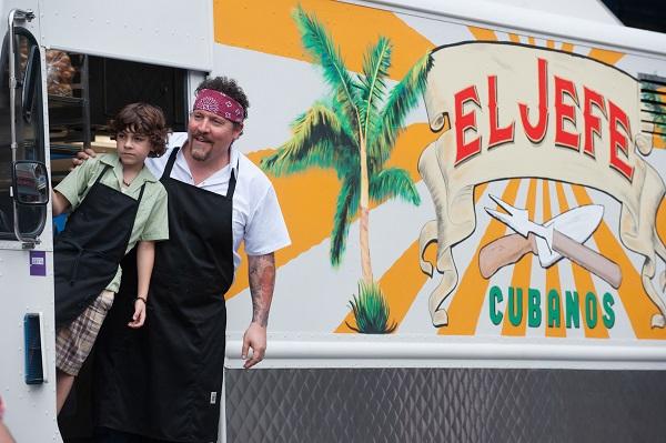 "Emjay Anthony as Percy Casper and Jon Favreau as Carl Casper in ""Chef."" Photo Credit: Merrick Morton."