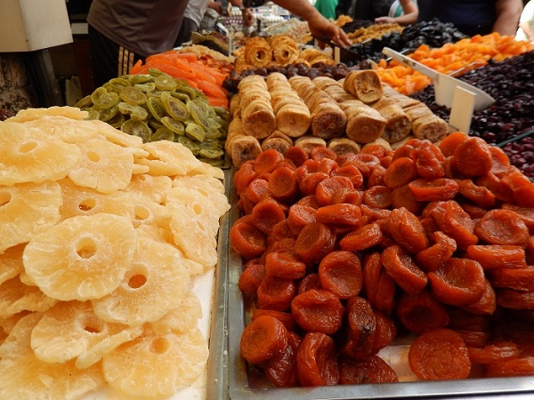 Dried fruits tempt the stomach at the Mahane Yehuda market, which is open seven days a week. Photo Credit: Benjamin S. Mack/GALO Magazine.