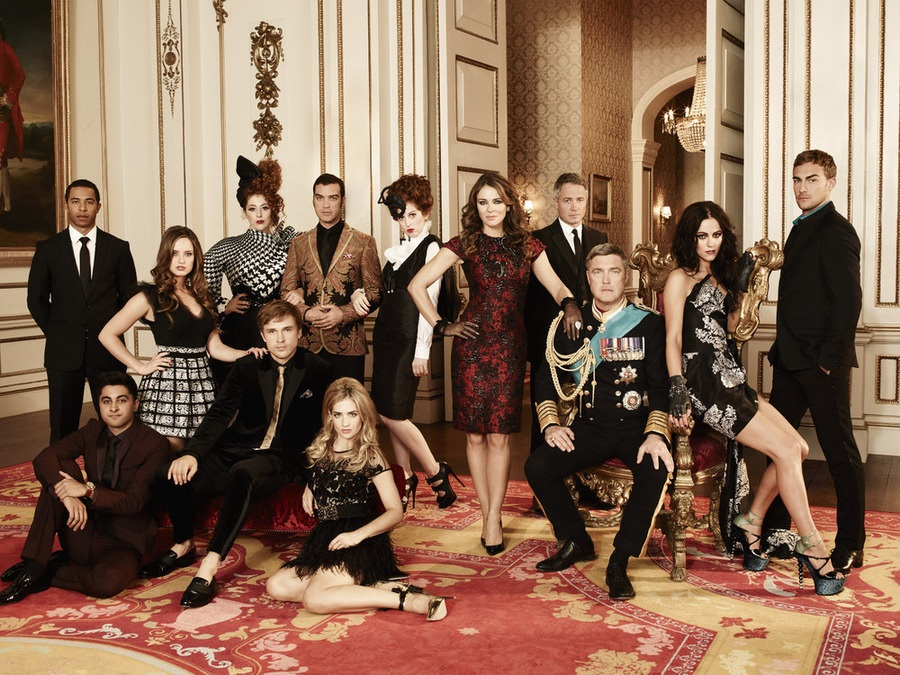 """The Royals"": Season: 1 -- Pictured: (l-r)  Manpreet Bachu as Ashok, Ukweli Roach as Marcus, Merritt Patterson as Ophelia, William Moseley as Prince Liam, Lydia Rose Bewley as Penelope, Jake Maskall as Cyrus, Sophie Colquhoun as Gemma, Hatty Preston as Maribel, Elizabeth Hurley as Queen Helena, Oliver Milburn as Ted, Vincent Regan as King Simon, Alexandra Park as Princess Eleanor, Tom Austen as Jasper. Photo by Frank W. Ockenfels 3/E! Entertainment."