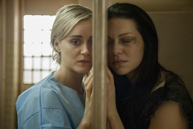 "Taylor Schilling and Laura Prepon in season 3 of Netflix's ""Orange is the New Black."" Photo Credit: JoJo Whilden/Netflix."