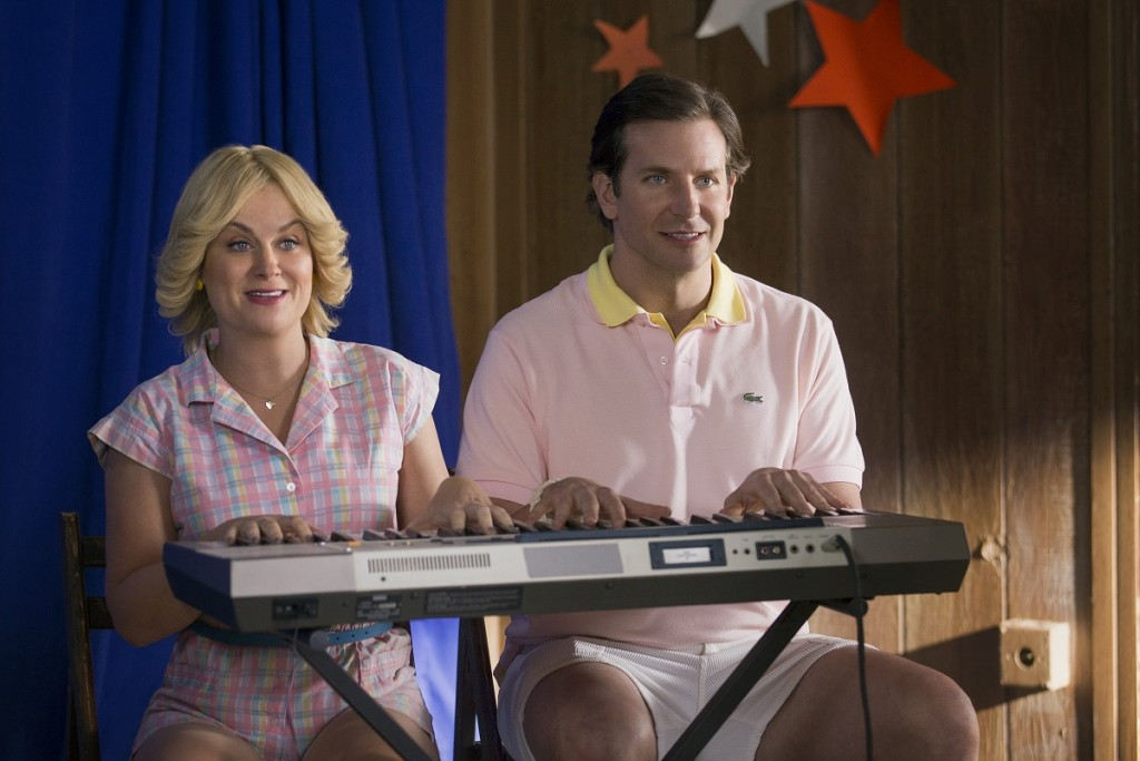 "Amy Poehler and Bradley Cooper in the Netflix original series ""Wet Hot American Summer: First Day Of Camp"". Photo by: Saeed Adyani/Netflix."