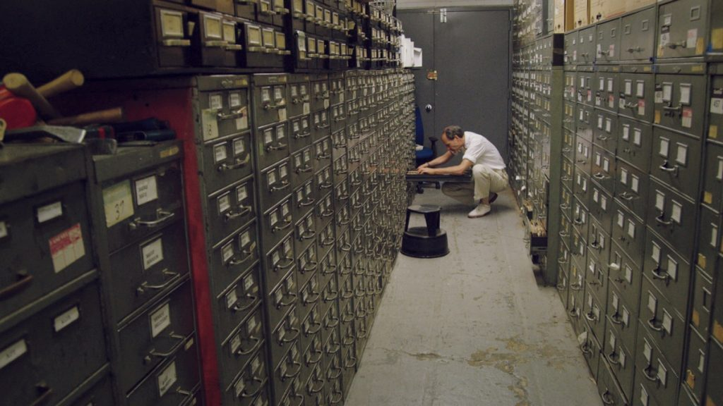 Last remaining archivist Jeff Roth searches the New York Times morgue. Photo Credit: Ben Wolf.