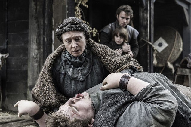 Annette Tierney as Old Nan and Sam Coleman as a young Hodor in Season 6 of Game of Thrones. Photo Credit: Helen Sloan/courtesy of HBO.