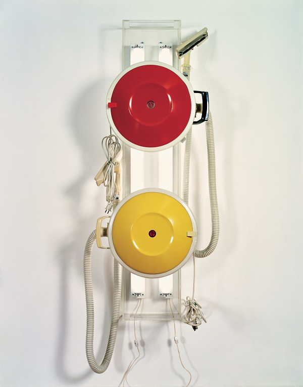 """Jeff Koons, """"New Hoover Celebrity III's,"""" 1980. Two vacuum cleaners, Plexigas, fluorescent lights; 56 x 11 x 12 1/2 in. (142.2 x 27.9 x 31.8 cm). Collection of Jeffrey Deitch. ©Jeff Koons. Photo courtesy of the Whitney Museum of American Art."""