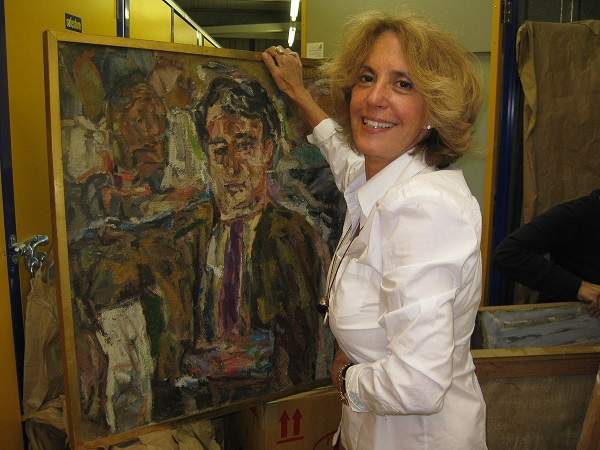 """Marcia Gloster, author of """"31 Days,"""" with a painting of Bill Thomson. Photo courtesy of Marcia Gloster."""