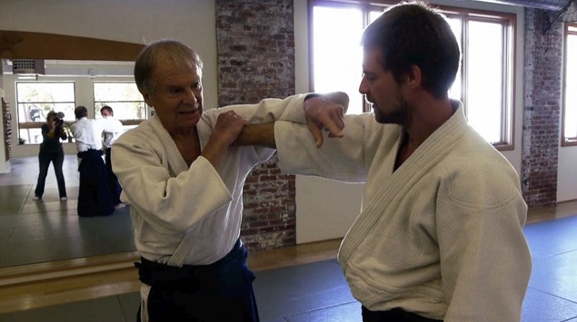 Ed Pincus practices Aikido with his son, Ben. Photo: Lucia Small.