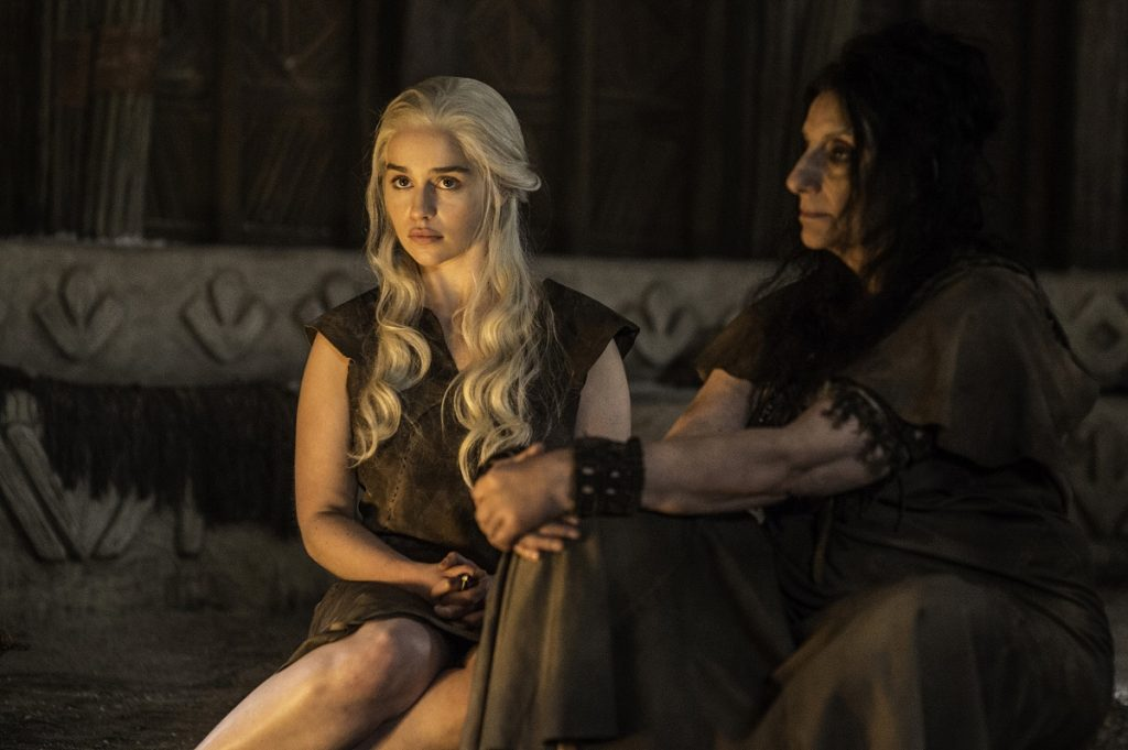 Emilia Clarke as Daenerys Targaryen and Souad Faress as the High Priestess in Season 6 of Game of Thrones. Photo Credit: Helen Sloan/courtesy of HBO.